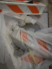Barriers in Bags (Matthew Cumbie) Tags: barriers found abstract walk orange covered street urban olympus 20mm