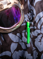 51 of Year 4 - Green & purple (Hi, I'm Tim Large) Tags: purple pen pocket goggles punk metal hard cotton shirt clip vert 365 51 goth gothic stilllife tabletop blue patten green colors colours