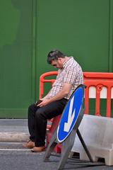 Phone time (jeremyhughes) Tags: london street green hoarding phone mobile mobilephone city urban roadworks streetfurniture barricade shades queenvictoriastreet man road d750 nikon nikkor 80200mmf28 summer