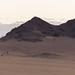 Hill with arid vegetation and rocks near Sesriem.