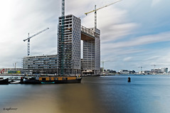 Amsterdam (alamsterdam) Tags: amsterdam pontsteigergebouw ij water longexposure architecture boats cranes sky clouds
