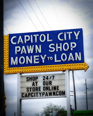 Pawned in Capitol City (Pete Zarria) Tags: kansas neon sign pawn sell buy loan