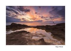 La caña de pescar (Paqui Ronda) Tags: amanecer caña benissa marina nubes colores rocas reflejos