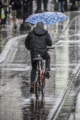 One way to keep dry (tootdood) Tags: canon70d piccadilly manchester wet rain reflection brolly umbrellas brollies metrolink tracks one way keep dry bike bicycle peddling