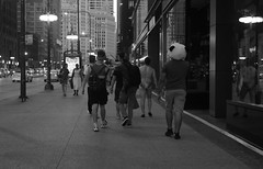 "Photo Essay: ""Mr. Speedo Takes Michigan Avenue by Storm""  - Chicago After Dark - 13 July 2017 - 80D - 107 - FRAME 1 of 15 (Andre's Street Photography) Tags: downtownchicago13july201780d twop street straat straatfotografie streetphotography afterdark nightphotography chicagosteets streettheater streetperformers chicago chicagoafterdark dark night nightlife streetlife urbanlife urbanphotography michiganavenue magnificentmile fotografiadistrada streetscene strasse strada mrspeedo zwartwit bw bwphotography schwarzweiss noiretblanc blancoynegro blackandwhte loop downtown innercity chitown illinois enjoyillinois aroundillinois chicagoist chicagoistphotos chicagojournal chicagotribune chicagoreader photobyandrevanvegten chicagostreets chicagostreetphotographer dutchstreetphotographer tributetoedvanderelsken robertfranksworld streetphotograpyforum streetphotographymagazine vivianmaiersstyle canon eos 80d eos80d prime efprime 40mmprime pancake pancakelens ef40mmstm candid"