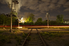 Flemington, NJ (• estatik •) Tags: flemington nj new jersey night long exposure tail lights tracks traffic cars hunterdon county industrial site factory freight ling clouds rr railroad crossing crossbuck river rd road