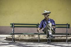 Man on Bench (Susan.Johnston) Tags: cuba happybenchmonday trinidad bench manonbench man sitting cowboyhat