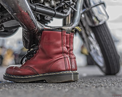 Air Wair (whistlingtent) Tags: drmartens airwair motorbike depthoffield dof bouncingsoles exhaust tarmac ubran oxblood stitching boots footwear tyre rubber