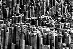 The Pillars of the Earth (micheledibitetto) Tags: column hexagon geometry pattern earth rock rocks pillars bw blackandwhite iceland vik basalt lava grey