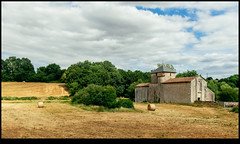 170624-2524-XM1.jpg (hopeless128) Tags: france 2017 prieurénotredame haybales vieuxruffec fields sky eurotrip church bales clouds chapel nouvelleaquitaine fr