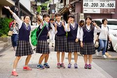 Energetic students (Eric Flexyourhead) Tags: higashiyama higashiyamaku 東山区 kyoto 京都市 kansai 関西地方 japan 日本 city urban street streetphotography girl girls students uniform schooluniform happy smiles smiling cute kawaii かわいい smile sonyalphaa7 zeisssonnartfe55mmf18za zeiss 55mmf18