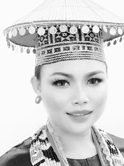 Borneo Woman (kieronjameslong) Tags: woman bw female lady head headshot borneo ethnic tribal tribe malaysia sarawak kuching asia fareast southeastasia hat headdress bead beads necklace costume traditionalcostume heritage culture