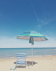 (laclairvoyance) Tags: umbrella beach stripes sea summer vintage old blue sand july