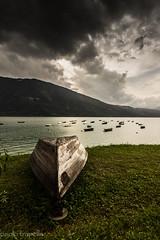 nel lago di santa croce (paolotrapella) Tags: santa croce lago barca acqua water cielo nuvole clouds sky