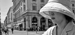 The sun shall not get through! (Baz 120) Tags: candid candidstreet candidportrait city candidface candidphotography contrast street streetphoto streetcandid streetphotography streetphotograph streetportrait rome roma romepeople romestreets romecandid europe monochrome monotone mono blackandwhite bw noiretblanc urban voigtlandercolorskopar21mmf40 voightlander leicam8 leica life primelens portrait people unposed italy italia girl grittystreetphotography decisivemoment strangers