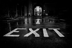 exit (Daz Smith) Tags: dazsmith fujixt20 fuji xt20 andwhite bath city streetphotography people candid portrait citylife thecity urban streets uk monochrome blancoynegro blackandwhite mono exit sign road puddles arch