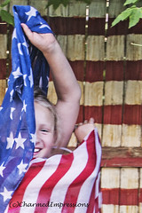 Posing (livininfrostytown) Tags: independenceday 4thofjuly growingup daughter child girl flag scarf painted fence outside charmedipressions 2017 summer july