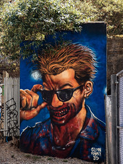 Proinsias Cassidy by Glenn Fabry (Steve Taylor (Photography)) Tags: glennfabry 95 proinsiascassidy vampire preacher blood earring sunglasses art cartoon graffiti mural streetart tag red blue green brown uk gb england greatbritain unitedkingdom london teeth