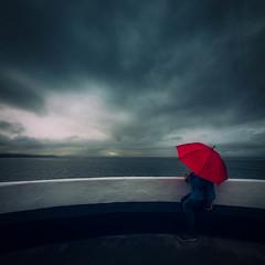 Awaiting the Storm (Timothy Gilbert) Tags: nikcollection panasonic umbrella cornwall looe gx8 banjopier samyang75mmf35