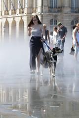 wet message (Henk Overbeeke Atelier54) Tags: girl street candid longhair skirt specs dog miroirdeau bordeaux
