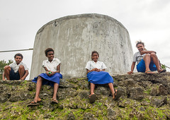 Teenagers in school uniforms sit in front of a concrete water tank, Shefa Province, Efate island, Vanuatu (Eric Lafforgue) Tags: a0009918 boy childhood colourimage day developingcountries development efateisland fourpeople freshwater frontview fulllength girls happiness horizontal lookingatcamera melanesia newhebrides nivanuatu oceania outdoors pacificislands people photography portrait school schooluniform shefaprovince sit southpacific storagetank teenagers tourism traveldestinations vanuatu watertank vut