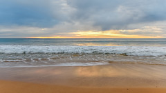 Cloudy Sunrise Seascape (Merrillie) Tags: daybreak sand landscape nature water newsouthwales sea nsw beach scenery waves newport clouds waterscape earlymornings australia dawn seascape