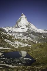 The Majestic Matterhorn and it's partial reflection on the half melted lake Rifflesee. (Sandhip-Ace) Tags: alps mountain nature travel majestic riffelsee zermatt matterhorn switzerland swiss