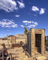 Open Seating (magnetic_red) Tags: outhouse building wood wooden decay mountains sky blue clouds desert nevada americanwest