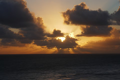 Sunrise in Kauai (Grazerin/Dorli B.) Tags: kauai sunrise island hawaii princeville coast ocean clouds waves glow sun elements