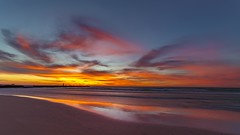 Sundowny sky in Ludington (Notkalvin) Tags: ludington michigan sunset beach lighthouse northpier wideangle fisheye colorful mikekline notkalvin outdoors lakemichigan notkalvinphotography sand shore westernmichigan