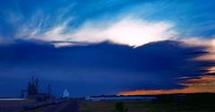 What will reach the town first? Storm? Sunset ? Us? (nelhiebelv) Tags: t storm cloud dark sunset railroad tracks train sidney nebraska