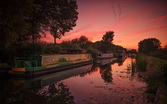 A Dash Of Red (Captain Nikon) Tags: erewashcanal canal sunset reds coincidences summer narrowboat dusk derbyshire longeaton uk greatbritain england eastmidlands reflections dash nikond7000 sigma1020mmf4 srb06graduatedneutraldensityfilter atmospheric moody