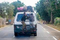 Two men hanging onto the back of an overloaded taxi brousse (Mazda Bongo) on the coastal road near Ifaty, Madagascar (Ulrich Münstermann) Tags: africa afrika city dorf madagascar mazda mazdaaccess mazdabongo mazdaeseries routenationale9 régiondeatsimoandrefana strase transportation automobile car cargo coastalroad dorp local men overloaded road straat street taxi taxibrousse transport village voiture