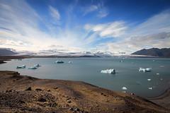 Jökulsárlón (Jack Landau) Tags: iceland nature landscape blue sky clouds weather north glacial lagoon glacier mountains water ice cliff rocks jack landau