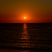 Angry looking Night sun Just about to dip out of Sight From the beachs of Cadiz Spain....