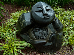 Pondering (Steve Taylor (Photography)) Tags: art sculpture carving black brown green stone asia singapore plant stripes african flowerdome gardensbythebay hapungusculpturemovement springstone zimbabwe pondering