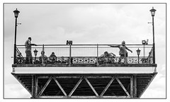 Sometimes you don't have to ask (A.I.D.A.N.) Tags: skegness pier seaside holiday piers lamp lamps blackwhite blackandwhite girl girls pose posing street monochrome person people persons sky high key waving stranger strangers endofthepier coast sea beach structure monochromatic monochromes fuji fujix100 fujifilm fujixseries x100 railing railings telescope telescopes coastal streetphotography