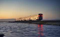 Amtrak has left San Jose, California (PeterThoeny) Tags: alviso california sanjose siliconvalley sanfranciscobay sanfranciscobayarea train railway amtrak alvisomarinacountypark slough pond saltpond reflection waterreflection track traintrack day clear dusk sky sunset bay outdoor sony sonya7 a7 a7ii a7mii alpha7mii ilce7m2 fullframe fe2870mmf3556oss 1xp raw photomatix hdr qualityhdr qualityhdrphotography water fav200