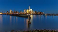 the skyline 2 (lukas schlagenhauf) Tags: manhattan newyork newyorkcity dusk cityscape jerseycity usa creativcommons hudson river skyline bluehour