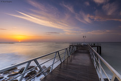 First Lights Over The Walkway III. (dasanes77) Tags: canoneos6d canonef1635mmf4lisusm tripod landscape seascape cloudscape perspective pier walkway sea ocean longexposure mediterraneansea xilxes castellón wood metallictextures sunrise sun reflections shadows clouds magiclight