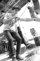 The MC (peterkelly) Tags: bw hillside hillsidefestival 2017 guelph ontario canada northamerica guelphlakeconservationarea music musician concert festival mike mic microphone singer singing lascafeteras emcee mc hat danielfrench stage digital