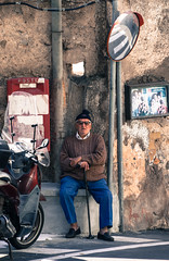 Watching the world go by.jpg (Darren Berg) Tags: elderly old decay motorcycle scooter poste post mail man cane sweather hat stocking red mirror wall road corner positano italy street stucco