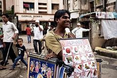 Alphabet seller (Mike Foo) Tags: india streetphotography street canon canon5dmark3 candid travel asia indian seller bombay mumbai city life