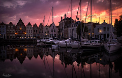 Dutch harbour charm (VandenBerge Photography (On/off ....but mostly off) Tags: goes habour nationalgeographic netherlands zeeland water evening reflection waterscape sky clouds light historical boats sunset purple city