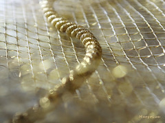 Golden Textures ... (MargoLuc) Tags: macromondays theme texture golden bokeh macro ribbon net cord natural light window backlight table indoor