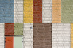 Wall with colored panels (on Explore) (Jan van der Wolf) Tags: map173210v wall muur composition compositie door colors colours panels vlakken lines lijnen deur abstract delft building architecture school bricks bakstenen