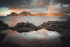 Faroe Sunset (martinzorn) Tags: faroe islands faroeislands sunset beach rocks travel photography rainbow reflection mirror evening summer wind sky water ocean stones cold mood moody sun clouds