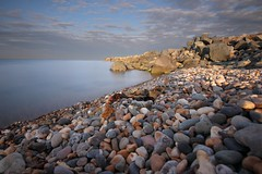 Stony Beach Arklow Co. Wicklow (Colin Kavanagh) Tags: stones beach rocks arklow wicklow cowicklow irelandinspires visitireland water breakwater clouds sky goldenhour sunset evening nopeople horizon windfarm coastline coastal longexposure ngc beacheslandscapes