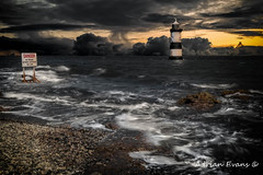 Lighthouse Storm (Adrian Evans Photography) Tags: puffinisland lighthouse danger trwyndu sunset penmon blackpoint water dangersign landmark outdoor clouds storm stones sea rocks wales british coastline sky penmonpoint uk trwyndulighthouse northwales boat pebbles seascape sign coast anglesey waves bythesea