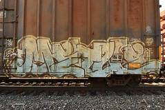 METUE (TheGraffitiHunters) Tags: graffiti graff spray paint street art colorful freight train tracks benching benched boxcar metue